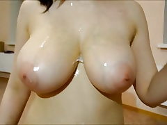 Chick gets a nice facial cumshot and plays with the jizz