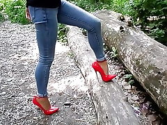Extraordinary stilettos and jeans, my splendid legs,walk in the woods