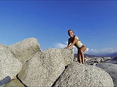 Climbing a Rock in a brief Sundress