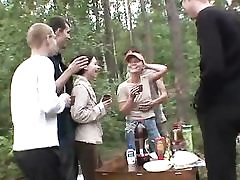 5 boys and 2 teenage women in the forest
